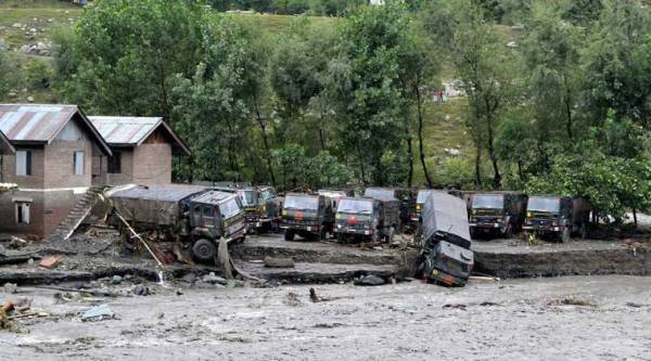 Army vehicles damaged by floods at Bonyar in Baramulla on Saturday. (Source: PTI)