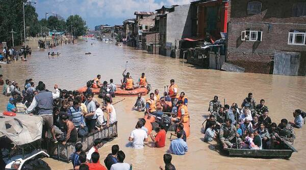 People being rescued from a flooded area in Srinagar on Wednesday. (Source: Express photo by Tashi Tobgyal)