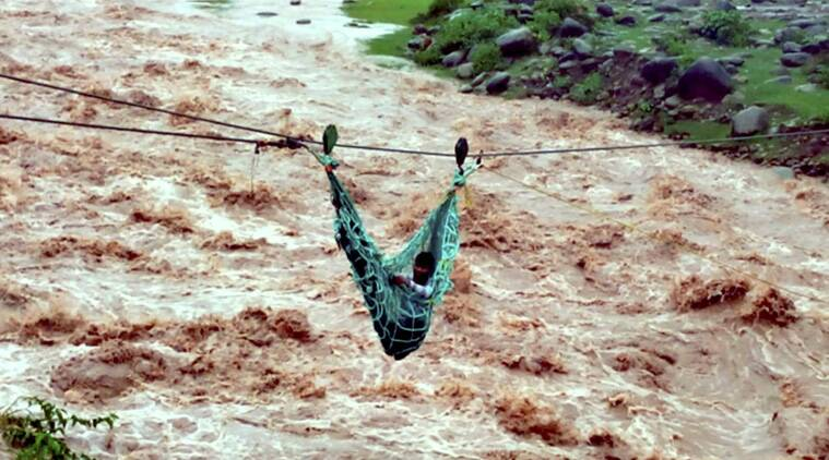 A flood-affected villager being rescued using a rope by the army at Thanamandi village of Rajouri on Friday. (Source: PTI)