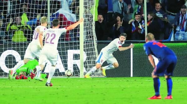 Vaclav Pilar of the Czech Republic (right) exults after Netherlands defender Daryl Janmaat's blunder handed him the winner in Prague. Source: Reuters