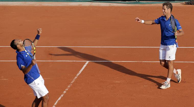After dropping the first set the French duo beat Tomas Berdych and Radek Stepanek 6-7(4) 6-4 7-6(5) 6-1 to earn victory with a day to spare at Roland Garros. (Source: AP)