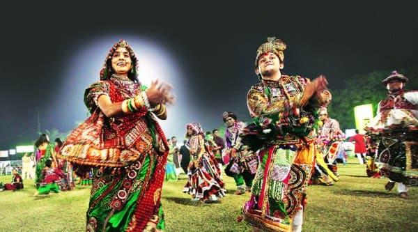 A couple do the dandiya-raas in Vadodara (Source: Express photo by Javed Raja)