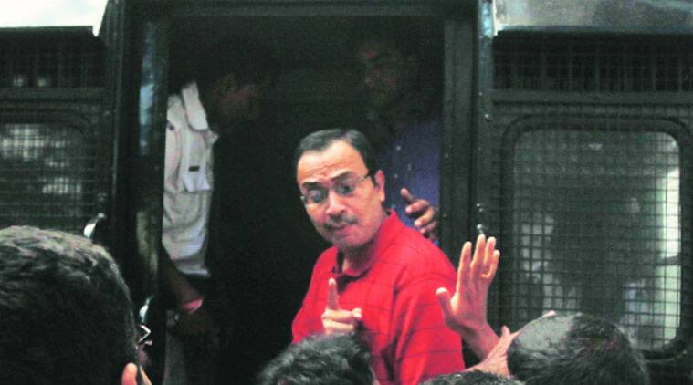 TMC MP Kunal Ghosh being taken into CBI custody from Kolkata City Sessions Court on Saturday. (Source: Express photo by Subham Dutta)