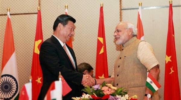 Prime Minister Narendra Modi shakes hands with the Chinese President Xi Jinping during the signing of agreements in Ahmedabad on Wednesday. Source: PTI Photo
