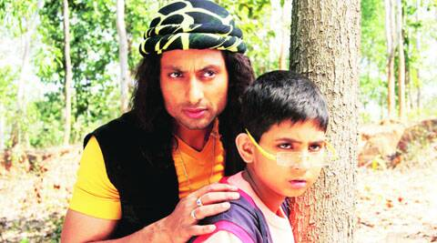 Indraneil Sengupta and Ahijit Ghish in  a still from Gogoler Kirti
