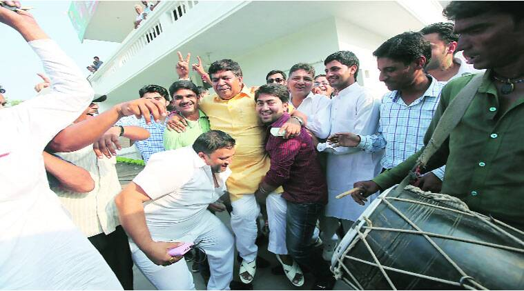 Gian Chand Gupta celebrates with supporters on Wednesday after he gets the BJP ticket to contest assembly elections from Panchkula. (Source: Express  Jaipal Singh)