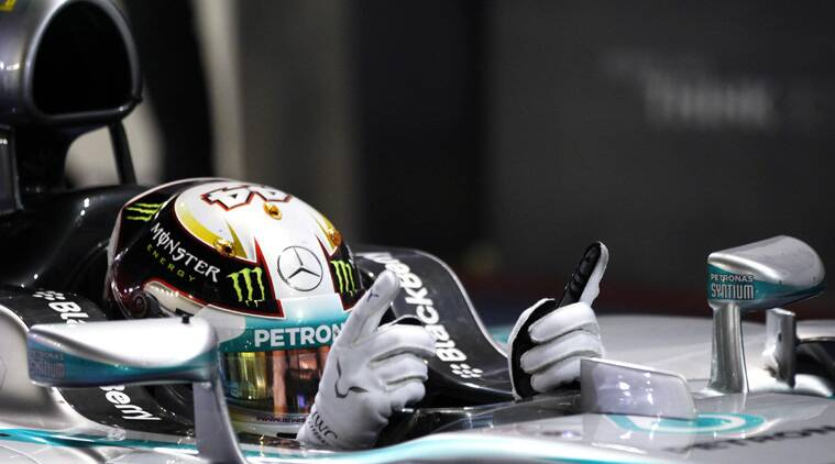 Lewis Hamilton of Britain gestures after winning the Singapore F1 Grand Prix (Source:Reuters)