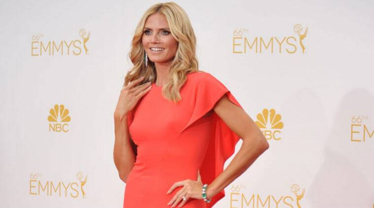Heidi Klum agreed to shed her clothes as part a new ad for gadget store The Sharper Image. (Source: AP)