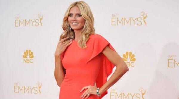 Heidi Klum is teaching her kids the importance of giving back. (Source: AP)