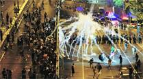 Defiant Hong Kong crowds leave police in a bind