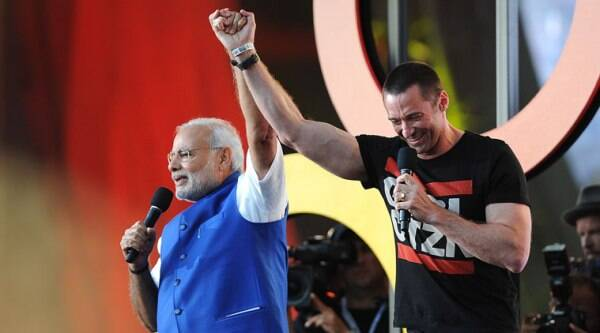 Prime Minister of India Narendra Modi, left and Hugh Jackman speak at the 3rd Global Citizen Festival at Central Park on Saturday, Sept. 27, 2014 in New York. (Source: AP)