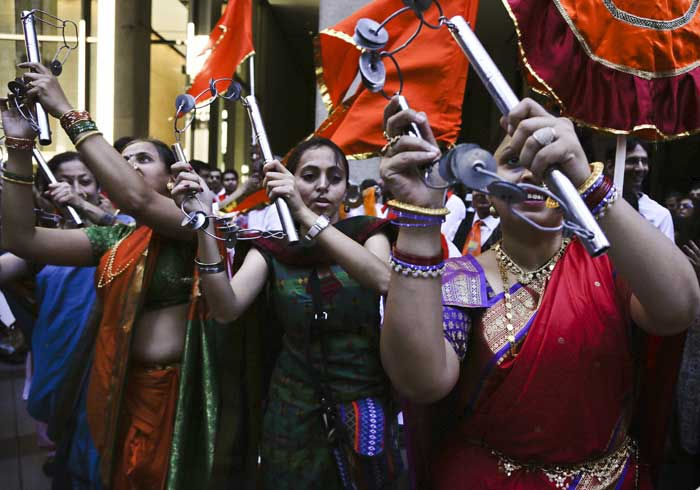 Dancers with an Indian cultural group perform outside Madison Square Garden in preparation for an appearance by Indian Prime Minister Narendra Modi on Sunday, Sept. 28, 2014, in New York. (Source: PTI)