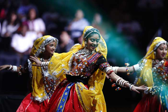 Traditional Gujarati dancers perform during a reception by the Indian community in honor of Indian Prime Minister Narendra Modi's visit to the United States at Madison Square Garden, Sunday, Sept. 28, 2014, in New York. (Source: PTI)