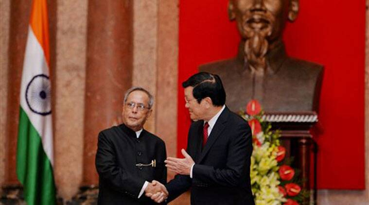 President Pranab Mukherjee shakes hands with his Vietnamese counterpart Truong Tan Sang at a meeting at the Presidential Palace in Hanoi. (Source: AP)