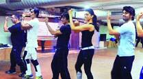 Vivaan Shah, Deepika Padukone, Shah Rukh Khan, Sonu Sood and Boman Irani  rehearse at the Red Chillies Entertainment office with  an assistant choreographer (second from left)
