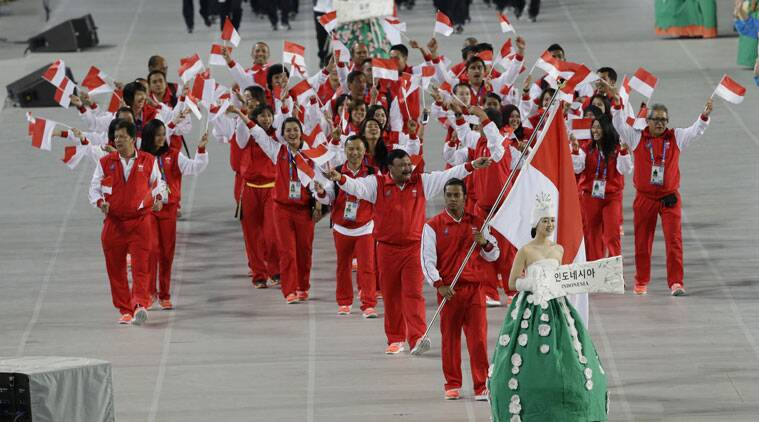 Athletes from Indonesia march into the stadium during the opening ceremony for the 17th Asian Games in Incheon, South Korea. (Source: AP)