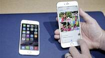 New iPhones run into software, bending complaints