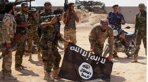 Iraqi security forces hold a flag of the Islamic State group they captured during an operation outside Amirli, some 105 miles (170 kilometers) north of Baghdad, Iraq, Monday, Sept. 1, 2014. (Source: AP)