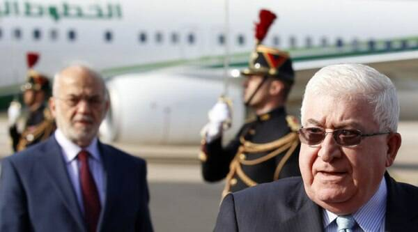 Iraq President Fouad Massoum, right, followed by Iraq Foreign Minister Ibrahim Al-Jaafari, left, arrive with Iraqi officials at Orly airport south of Paris, France, Sunday, Sept. 14, 2014 ahead of a conference with U.S. Secretary of State John Kerry, French President Francois Hollande and diplomats from around the world. (Source: AP)