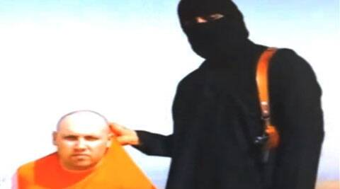 This still image from an undated video released by Islamic State militants on Tuesday, Aug. 19, 2014, purports to show journalist Steven Sotloff being held by the militant group. ( Source: AP )