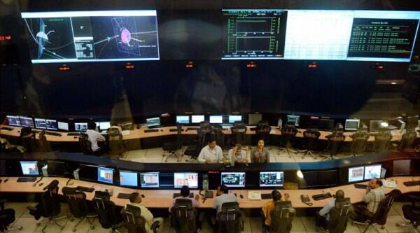 Scientists and engineers from the ISRO monitor India's Mars Orbiter Mission (MOM) at ISRO Spacecraft Control Centre, Peenya in Bengaluru on Monday. (Source: PTI photo)
