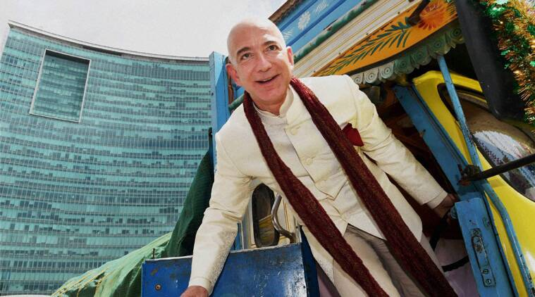 Jeff Bezos, founder and CEO of Amazon, poses as he stands on a supply truck at the premises of a shopping mall in Bangalore. (Reuters)