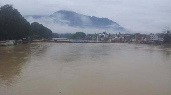 A view of river Jehlum flowing over Zero Bridge at Rajbagh Srinagar. (Express Picture by Basharat Masood)