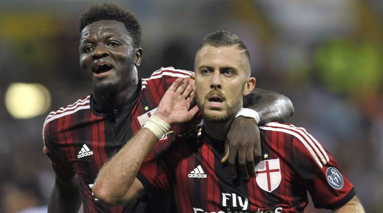 AC Milan's Jeremy Menez of France, right celebrates with his teammate Sulley Muntari of Ghana after scoring during a Serie A soccer match between AC Milan and Parma (Source: AP)