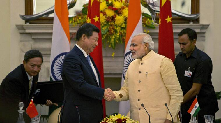 Chinese President Xi Jinping shakes hands with Indian Prime Minister Narendra Modi, right after signing agreements in New Delhi on Thursday. (Source: AP)