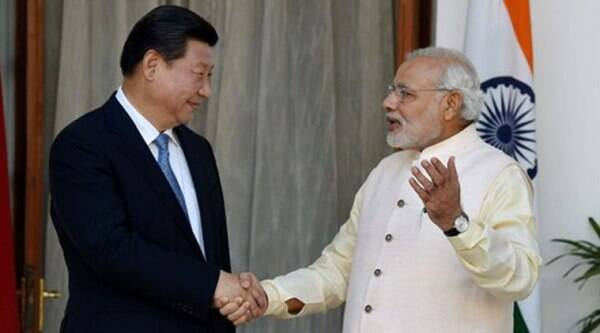 Prime Minister Narendra Modi and Chinese President Xi Jinping prior to a meeting at Hyderabad House in New Delhi on Thursday. (Source: PTI photo)