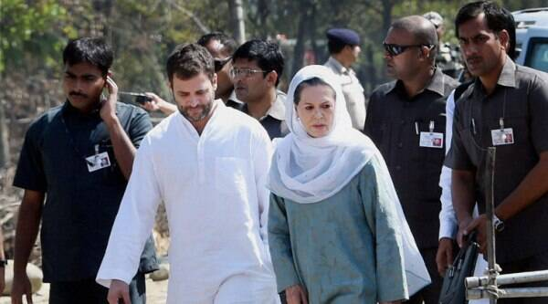 Congress president Sonia Gandhi along with party Vice President Rahul Gandhi during a meeting with flood affected people at Dehruna village of Anantnag district of South Kashmir on Monday. (Source: PTI)
