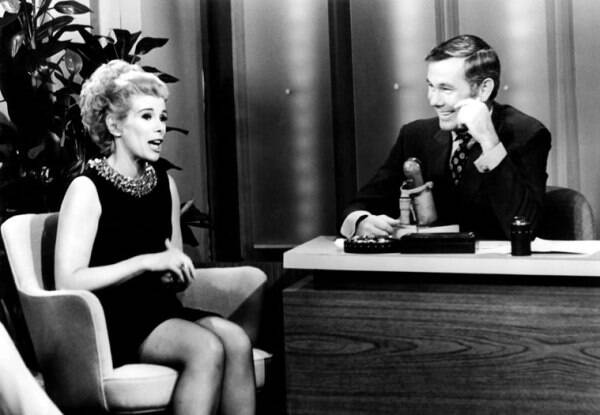 "This undated image released by NBC shows comedian Joan Rivers, left, and host Johnny Carson during ""The Tonight Show Starring Johnny Carson,"" in Burbank, Calif. Rivers, the raucous, acid-tongued comedian who crashed the male-dominated realm of late-night talk shows and turned Hollywood red carpets into danger zones for badly dressed celebrities,  died Thursday, Sept. 4, 2014. (Source: AP)"