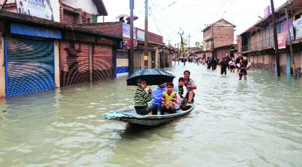 People being evacuated in boats, in Srinagar on Thursday. (Express photo by Shuaib Masoodi)