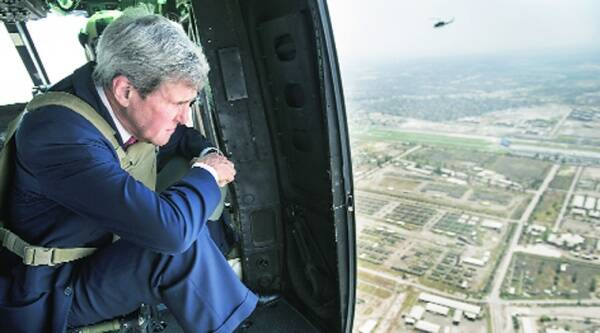 US Secretary of State John Kerry looks out from a helicopter over Baghdad on Wednesday.Source: AP
