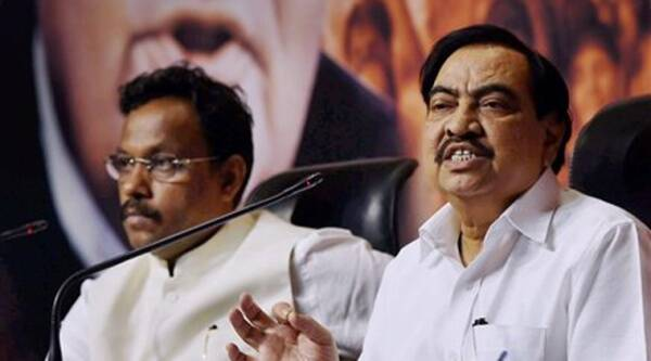 Maharashtra BJP leaders Eknath Khadse and Vinod Tawade during a press conference after a meeting with party President Amit Shah at party headquarter in New Delhi. Source: PTI photo