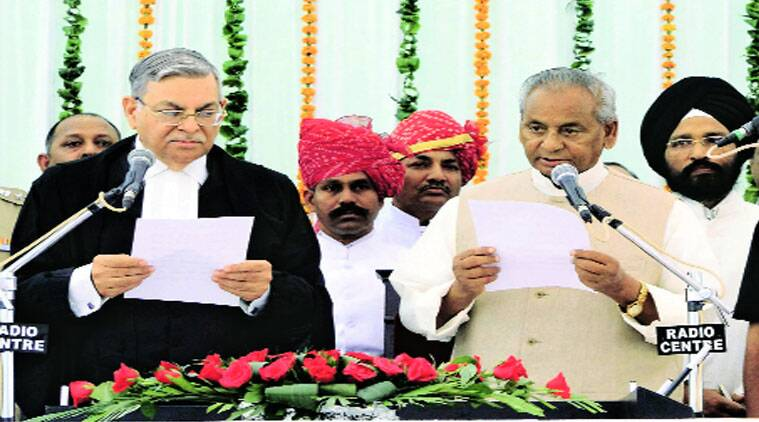 Rajasthan Chief Justice Sunil Ambwani administers oath of office to Kalyan Singh at Raj Bhawan in Jaipur.