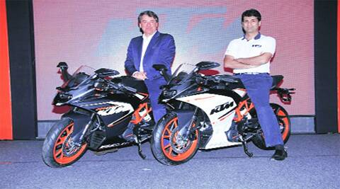 KTM's CEO Stefan Pierer with Bajaj Auto MD Rajiv Bajaj at the launch of superbikes — the RC 390 and the RC 200 — in Pune on Tuesday.