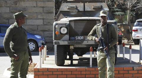 In this Sunday, Aug. 31, 2014 photo, army personnel man outside the military headquarters in Maseru, Lesotho. Lesotho's prime minister fled to South Africa in fear for his safety and will now meet with leaders of the region there to seek peace, he said Sunday. (Source: AP)