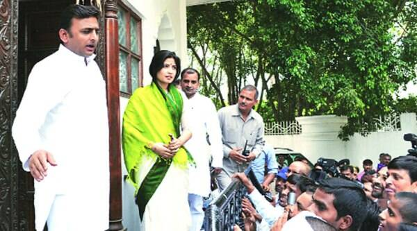 Chief Minister Akhilesh Yadav with wife Dimple Yadav and brother Anurag Yadav, after polling, at their Mainpuri house Saturday. (Express)