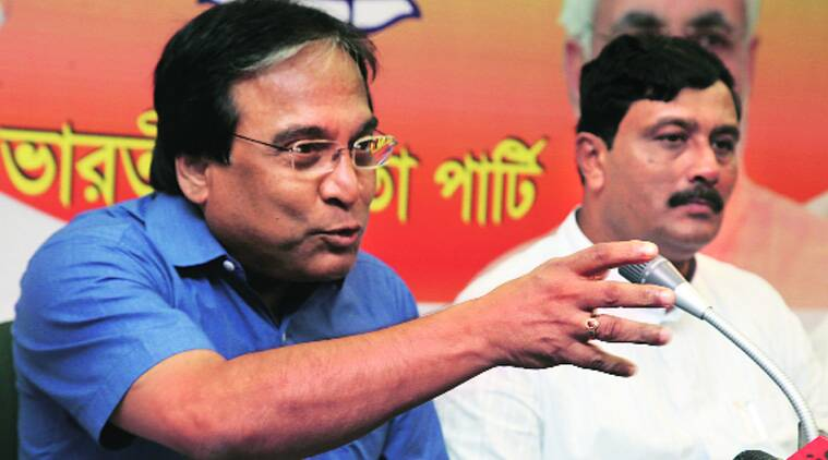Jayprakash Majumder (left) with BJP state president Rahul Sinha in Kolkata on Thursday. (Source: Express photo by Partha Paul)