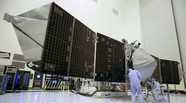 In this 2013 file photo, technicians work on NASA's Mars-bound spacecraft. The Maven spacecraft reached Mars after completing the 442 million mile journey from Earth. (Source: AP photo)
