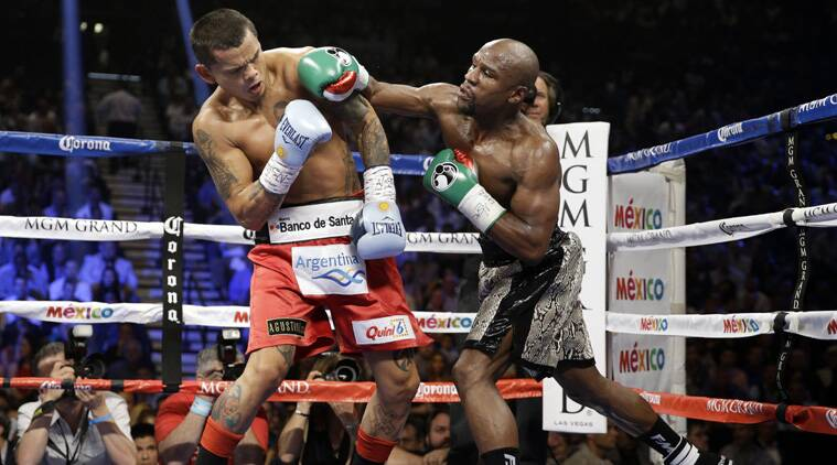 Mayweather lands a punch on Marcos Maidana during their bout. (Source: AP)