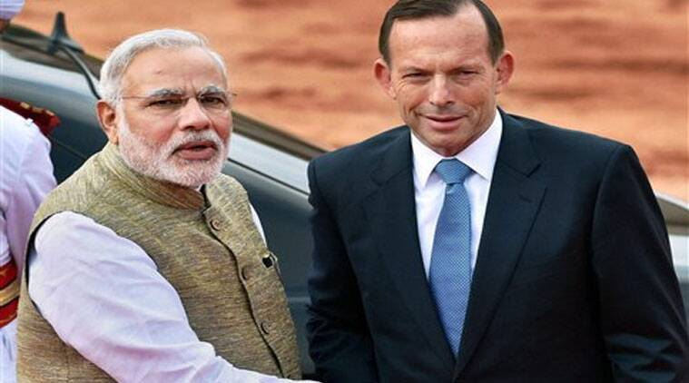 Prime Minister Narendra Modi shakes hands with his Australian counterpart Tony Abbott during a ceremonial reception at Rashtrapati Bhavan in New Delhi. (Source: PTI)
