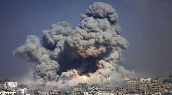 FILE - In this July 29, 2014 file photo, smoke and fire from the explosion of an Israeli strike rise over Gaza City. (Source: AP)