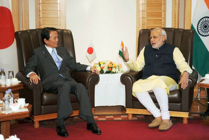 Narendra Modi, right, speaks with Japan's Finance Minister and former Prime Minsiter Taro Aso at the start of their meeting at a Tokyo hotel Monday. Modi was on his official visit to Japan. (Source: AP)