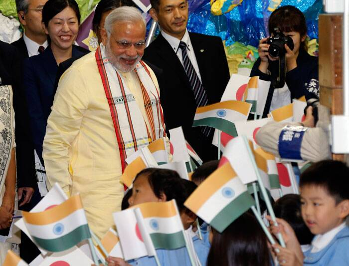 Prime Minister Narendra Modi is welcomed as he visits Taimei Elementary School in Tokyo on Monday. (Source: AP)