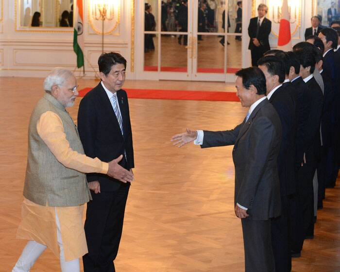Prime Minister Narendra Modi is introduced by Japanese Prime Minister Shinzo Abe, second left, to Japanese Finance Minister Taro Aso during a welcome ceremony at Akasaka State Guesthouse in Tokyo Monday, Sept. 1, 2014. Modi was on his official visit to Japan. (Source: AP)