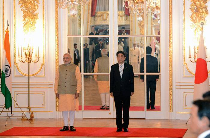 Prime Minister Narendra Modi, left, and Japanese Prime Minister Shinzo Abe listen to national anthems during a welcome ceremony at Akasaka State Guesthouse in Tokyo Monday, Sept. 1, 2014. Modi was on his official visit to Japan. (Source: AP)