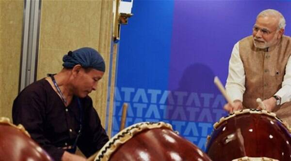 Narendra Modi beating a traditional Taiko drum during inauguration of the Tata Consultancy Services (TCS) Japan Technology and Culture Academy in Tokyo. (PTI Photo)