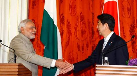 Narendra Modi, left, shakes hands with Japanese Prime Minister Shinzo Abe after a Japan-India Joint press conference at Akasaka State Guesthouse in Tokyo. (Source: AP)